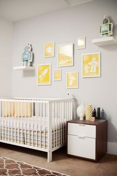 yellow and gray nursery with a robot theme