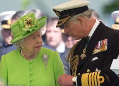 Mother and son: Prince Charles and The Queen share a moment together in the midst of the commemoration ceremony in Bayeux