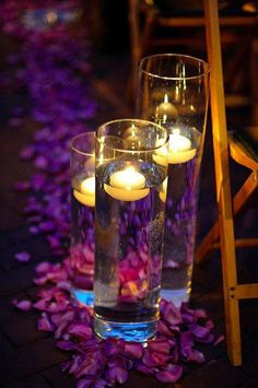 Cute idea for lining the aisle with flower petals and floating candles