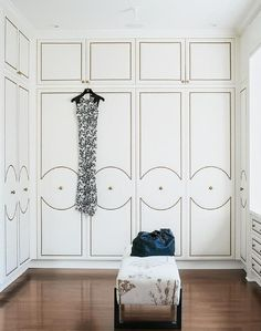 Walk In Closet with Upholstered Wardrobe Doors with Brass Nailhead Trim