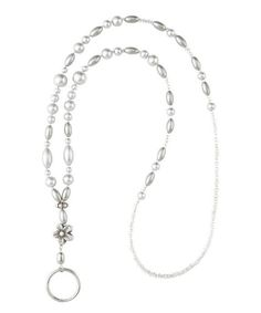 Take a look at this White Fleur Behold Eyeglass Chain & Badge Holder today!