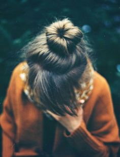 Topknot paired with blunt bangs