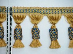 """4"""" High-end Pineapple Tassel Fringe Trim Gold Navy Per Yard by HappyGoodBuy.com. $9.95. This extremely high quality handmade palace style trim makes it perfect for any High-end setting. It will enhance the beauty of home decorations on CLASSIC custom bedding, window treatments, pillows/cushions, table coverings, slipcovers, and other craft projects."""