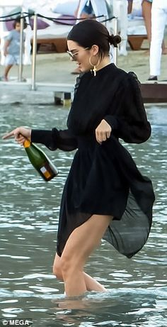 Still drinking: She clutched tightly to her drink