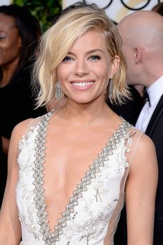 Sienna Miller What winter? With her beachy waves, bronze skin and pale pink lipstick, Miller looked the part of California beach girl. Getty Images