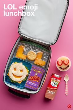"""Get their attention with this fun, emoji-themed lunchbox. Complete with a smiley-face sandwich, heart emoji-faced applesauce and """"LOL"""" made out of cheese. Add in an emoji note and kids are sure to feel the love."""