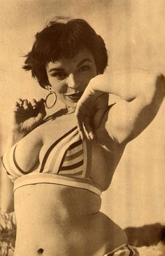 A glamour model poses in a bikini, 1959. Reblogged from hollyhocksandtulips