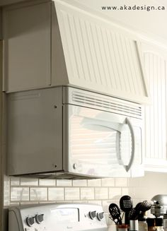 over the range Our Imperfect White Kitchen - maybe put hinges along the top to access storage space? Above Range Microwave, Over The Stove Microwave, Microwave In Kitchen, Kitchen Hoods, Updated Kitchen, New Kitchen, Kitchen Ideas, Space Kitchen