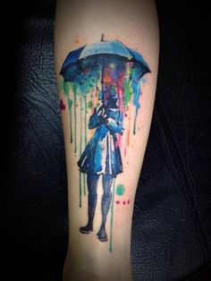 "Instead, I want umbrellas blowing in the wind down my upper arm, storm clouds, and ""I'll never need umbrellas in the rain"" along the side of it."