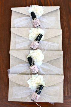 """Bridesmaids' gifts: burlap clutches - """"beachy pearl white flower"""" from The Sweetest Memory on Etsy. I tied OPI """"Mimosas for the Mr. & Mrs."""" nail polishes onto them"""