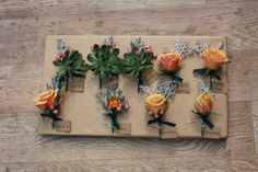 Buttonholes and Corsages for the Grooms family #Buttonholes #Corsages #Roses #Succulents #Wedding #Flowers