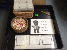 Small challenge table, where children find their personal challenge book and complete a different challenge each day. This one is to help Rastamouse answer the addition sums, using the mini cubes and an addition mat.
