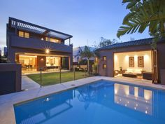 In-ground pool design using tiles with cabana & outdoor furniture setting - Pool photo 437467