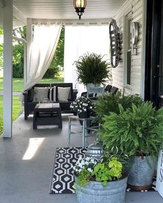 Sunny summer porch with outdoor curtains big wreaths in galvanized buckets. Black and white porch decor - Outdoor Curtains - Ideas of Outdoor Curtains Porch Makeover, Backyard Makeover, Backyard Patio Designs, Backyard Landscaping, Patio Ideas, Porch Ideas, Landscaping Ideas, Backyard Ideas, Modern Farmhouse Porch