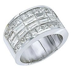 This beautiful treasure is entirely hand crafted in pure 18kt white solid gold. This 'one of a kind' ring is laced with a double row of invisible set baguette cut diamonds down the middle and outlined...