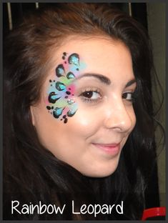 Rainbow Leopard Face Painting - this would look really cool tweaked to a peacock theme too!