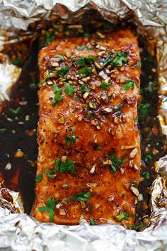 Juicy and flaky foil baked salmon recipe with a mouthwatering garlic sriracha marinade. Grilled Salmon Recipes, Fish Recipes, Seafood Recipes, Cooking Recipes, Soup Recipes, Salmon Dishes, Fish Dishes, Easy Delicious Recipes, Healthy Recipes