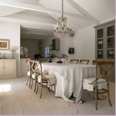 this chandelier really ups the elegance of this casual dining space