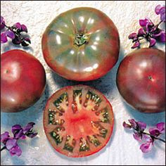 TRANSPLANT Cherokee Purple. Introduced by North Carolina SSE member Craig LeHoullier in 1991 from seed obtained from J. D. Green of Tennessee. Uniquely colored dusty rosebrown fruits weigh up to 12 ounces. Delicious sweet flesh. Indeterminate, $3 /plant.