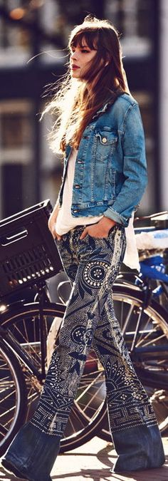 "Normally, denim jackets make me cringe, but the 70s vibe with flare pants in a studded ""print"" won me over."