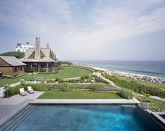 The project involved the design and construction of a new home in addition to the renovation of existing structures, which required cohesion between the designs for a compound-like feeling. Katherine Field & Associates oversaw the landscape design for the project and designed the infinity edge pool.