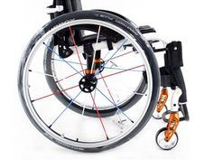 Different coloured spoked wheels on a manual wheelchair.