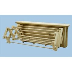 """DIY - Pullout wood drying rack expands to 22"""" and folds up to a compact 6"""" when not in use. solid pine pieces are firmly secured with screws, which are inset and covered with birch buttons. The extension rack is made of 1"""" x 3/4"""" pine legs and contains 12 birch dowels (3/8"""" x 22 1/2"""" ea.). Made of white pine, with dowels and pegs of birch. Dimensions: 12.25"""" H x 27"""" W x 6"""" D (closed) - 22"""" D (open). Top shelf is 5 1/2"""" wide."""