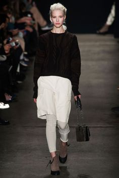 Rag & Bone, New York Fashion Week Fall 2014. Brown oversized sweater, cream straight-down skirt and matching leggings, brown ankle boots, chained handbag. So cool!