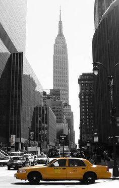 """""""Empire state and NYC Taxi"""" by John Wardell, Sheffield // Black and white print of a yellow New York City taxi cab in front of the Empire State Building NYC // Imagekind.com -- Buy stunning, museum-quality fine art prints, framed prints, and canvas prints directly from independent working artists and photographers."""