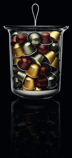 Nespresso Ritual Swirl Capsule Dispenser | Reminiscent of a classic glass ice bucket, this glass and stainless steel dispenser lets you easily choose the next Grand Cru to enjoy.
