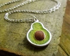 """Avocado Necklace: Made of silver and concrete. So yummy. Approx. 7/8"""" tall."""