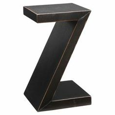 "A perfect addition to your living room or den, this charming wood accent table showcases a z-shaped silhouette and timeless black finish.     Product: Accent table   Construction Material: Wood   Color: Black  Features:Z-shaped silhouette   Dimensions: 25.5"" H x 15"" W x 15"" D"