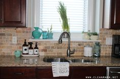 Clean Sink via Clean Mama - I like the two little groupings on either side of the windowsill and need something like that on mine.