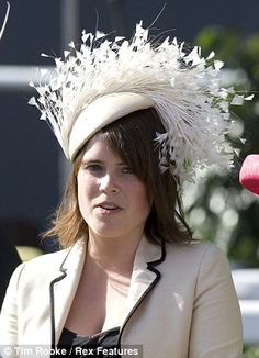 hats royal wedding | At another fancy occasion, Princess Eugenie wears a feather headpiece ...