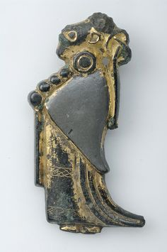 Pendant, female figurine. Silver, gilded. The figurine may represent Frigg, the most powerful of the Asynjurs. Grave find, Tuna, Alsike, Uppland, Sweden. SHM 10035: III (F23)
