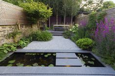 To Design a Stunning, Practical Patio Part Patio Design in 5 Steps Flamed Black Basalt paving from CED Natural Stone. Designer and Image: John Davies.Flamed Black Basalt paving from CED Natural Stone. Designer and Image: John Davies. Small Patio Design, Zen Garden Design, Pond Design, Fence Design, Modern Landscape Design, Modern Landscaping, Backyard Landscaping, Landscape Edging, Modern Pond