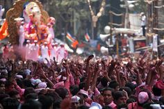 A massive crowd gathers for the culmination of the Ganesh Chaturthi festival in Lalbaug, Mumbai, India.