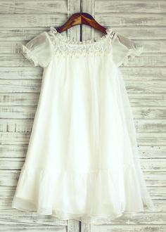 The dress is made of high quality chiffon and lace fabric.This dress is inspired by Kate Moss's Wedding Flower girls.Here is the link for your reference:http://www.pinterest.com/pin/184084703490111439/.It has short puffy sleeves and we made the top in lace.You might love the skirt we made.Perfect fo