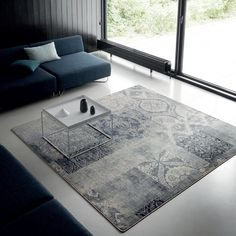 Ege's patchwork carpet adds to this living room space without taking away from the beautiful windows.