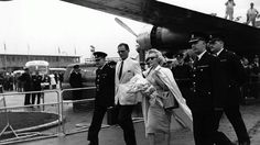 Circa 1956: American actress Marilyn Monroe arrives at London airport with her husband, playwright Arthur Miller. (Terry Fincher & Douglas Miller/Keystone/Getty Images)