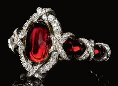 EXCEPTIONAL GARNET AND DIAMOND BRACELET, CIRCA 1860 The centre set with an oval cabochon garnet within a border of circular-, single-cut and rose diamonds, to a tapered bracelet of polished garnets highlighted with a diamond set ribbon motif, length approximately 210mm, Russian marks and workmasters mark, accompanied by later fitted case, Rath.