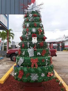Tire Christmas Tree... Have a Redneck/Ugly Sweater Christmas party featuring this tire tree. LOL