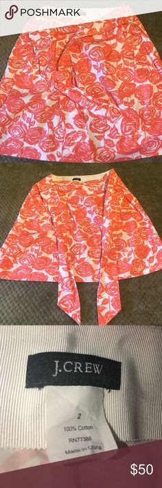 J. Crew Floral Tie Front Skirt IMP the cutest orange and white skirt with what looks like roses and stems. Ties in the front with to front pockets to finish off the look. 100% Cotton. Only worn and washed a once or twice. J. Crew Skirts