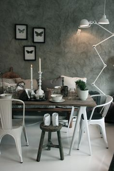 Farm house chic, and grey textured wall. Rag rolled? Suede paint?