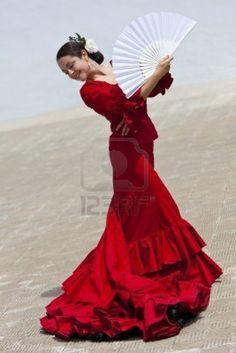 Traditional Spanish Flamenco Dancer Dancing In A Red Dress. #fan #flamenco #red
