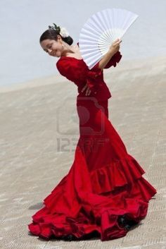 Traditional Spanish Flamenco Dancer Dancing In A Red Dress. #fan #flamenco #red
