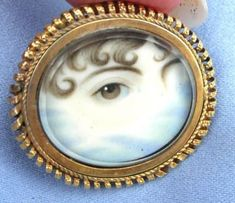 A portrait of the dead, using only the eye. 18 Haunting Pieces Of Memento Mori Antique Jewelry, Vintage Jewelry, How To Wear Rings, Lovers Eyes, Round Eyes, Art Deco Diamond, Diamond Brooch, Miniature Portraits, Mourning Jewelry
