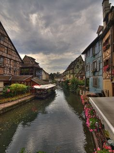 "Colmar, France. This section is known as ""La Petite Venise"" - Little Venice. I LOVE the colorful half-timbered buildings!"
