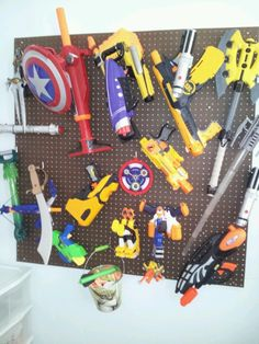 Peg board and hooks... great for Nerf guns! Hang a bucket up for ammo
