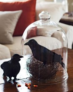 """I copied this on my buffet in my dining room this year.  I used mostly black and white decorations including a glitter haunted house, skeleton bones, an """"elegant"""" skull (it's really nice!) and a black feather tree with glass ornaments."""